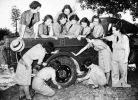 Rockhampton, Qld. c.1941-10. Women's National Emergency Legion learn how to change a tyre