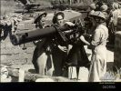Belmont, Qld. 1944-01-09. Australian Women's Army Service at the Heavy Anti-Aircraft small arms training school, using a range finder for aircraft spotting and targeting