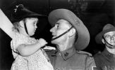Glenis Anderson welcomes her father Clark home from the war, Brisbane, February 1940